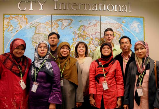CTY is hosting a delegation of Malaysian educators for a month of training and observations of CTY's classrooms. Pictured with the Malaysian educators in CTY's Mount Washington office are executive director Lea Ybarra and Simeon Brodsky, director of CTY International.