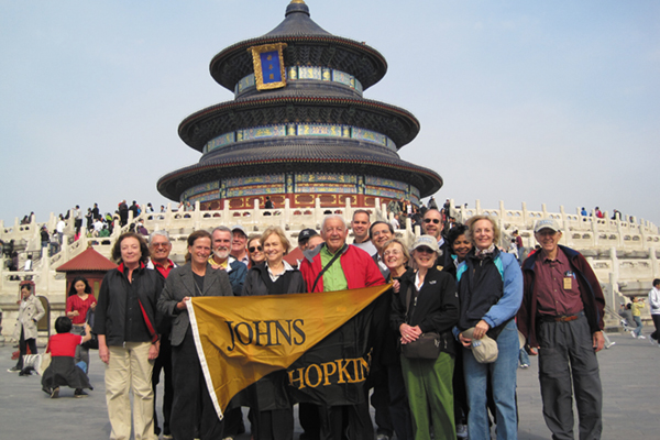 Johns Hopkins travelers on the October 2009 'Classic China and the Yangtze' trip stop for a group photo at the Temple of Heaven in Beijing.