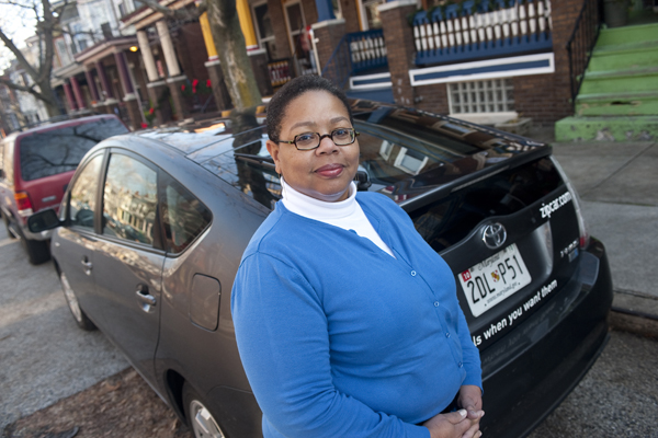 Brenda Armour and her favorite Zipcar: a Prius named Parlett. Photo: Will Kirk/Homewoodphoto.jhu.edu