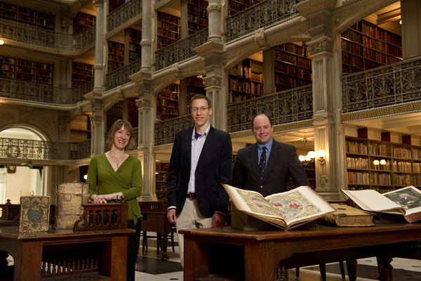 Elizabeth Rodini, Nick Spicher and Earle Havens in Johns Hopkins' George Peabody Library, where 'Collections and Communities: Baltimore Today' will be held. Photo: Will Kirk/Homewoodphoto.jhu.edu